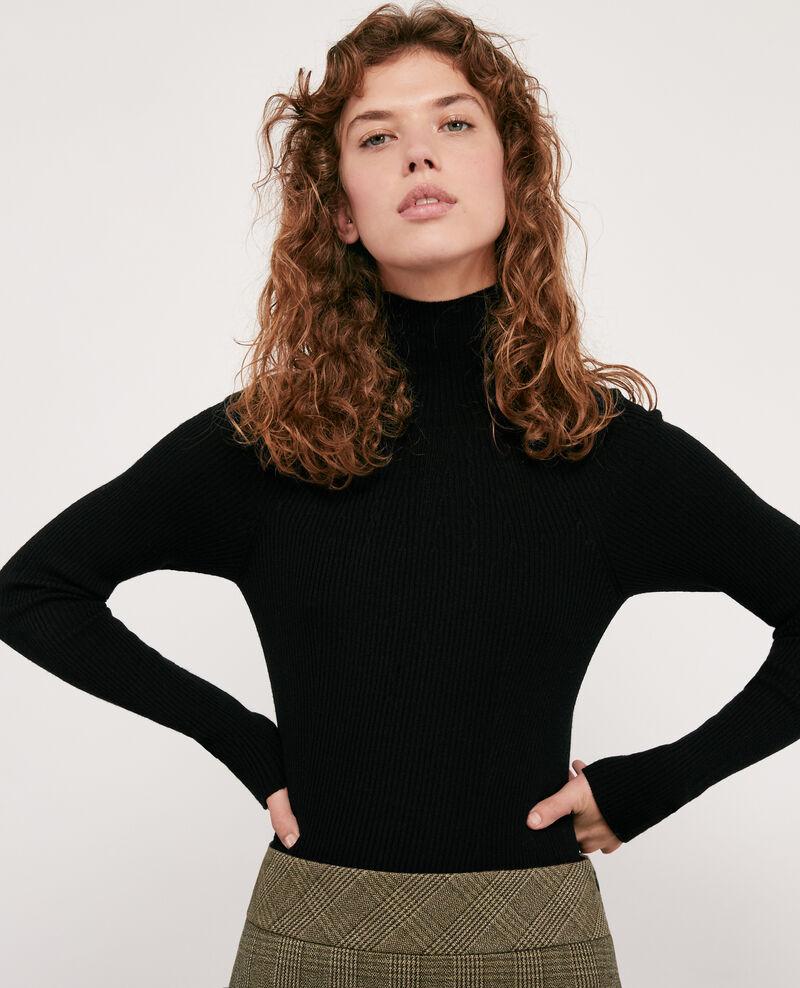 Nahtloser Rippstrickpullover aus 100 % Wolle Noir Determiner